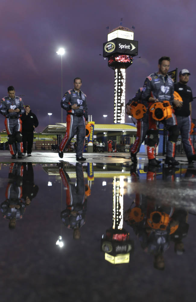 Johnson stays on track during late caution, wins at Kansas