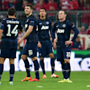 Manchester United's Wayne Rooney, right, looks on after Munich scored the third goal during the Champions League quarterfinal second leg soccer match between Bayern Munich and Manchester United in the Allianz Arena in Munich, Germany, Wednesday, April 9,