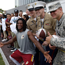 Washington Redskins receiver Andre Roberts poses for a picture with member of the military on Military Appreciation Day, after practice at the team's NFL football training facility, Sunday, July 27, 2014 in Roanoke, Va The Associated Press