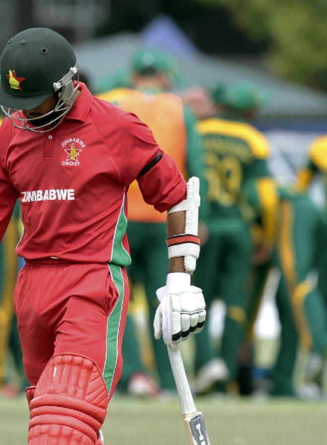 Zimbabwe batsman Sakandar Raza walks off the pitch after been dismissed during the One Day International cricket match against South Africa in Harare, Zimbabwe, Thursday Sept. 4, 2014