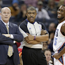 Charlotte Bobcats head coach Steve Clifford, left, and Kemba Walker, right, joke with referee Tony Brothers, center, during the first half of an NBA basketball game after the game in Charlotte, N.C., Monday, Dec. 9, 2013 The Associated Press