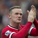 Manchester United's Wayne Rooney applauds supporters as he walks from the pitch after his team's English Premier League soccer match against Queens Park Rangers at Old Trafford Stadium, Manchester, England, Sunday Sept. 14, 2014