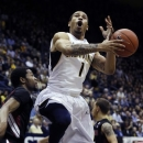 California's Justin Cobbs (1) loses control of the ball in front of Stanford's Chasson Randle during the first half of an NCAA college basketball game, Wednesday, March 6, 2013 in Berkeley, Calif. (AP Photo/George Nikitin)