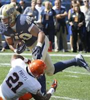 Pittsburgh running back James Conner (40) breaks a tackle by Virginia safety Brandon Phelps (21) on his way to a first-quarter touchdown in an NCAA football game Saturday, Sept. 28, 2013 in Pittsburgh. (AP Photo/Keith Srakocic)