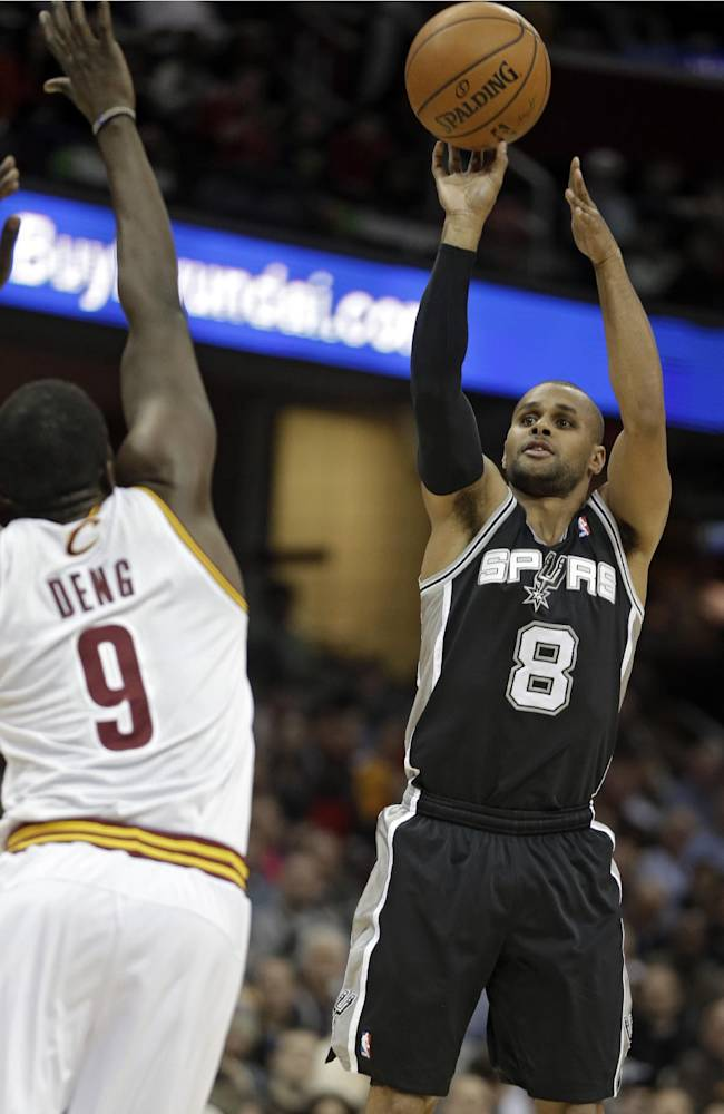 San Antonio Spurs' Patty Mills (8) shoots over Cleveland Cavaliers' Luol Deng (9) during the first quarter of an NBA basketball game Tuesday, March 4, 2014, in Cleveland