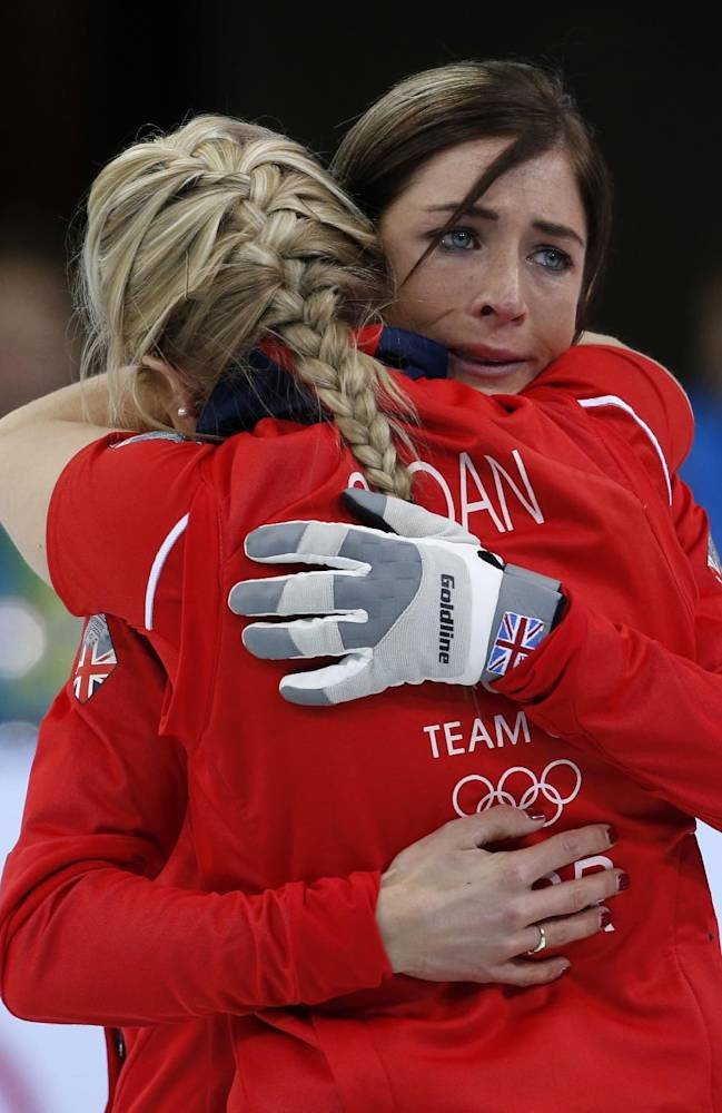 Britain's skip Eve Muirhead, right, embraces Anna Sloan after defeating Switzerland to win the women's curling bronze medal at the 2014 Winter Olympics, Thursday, Feb. 20, 2014, in Sochi, Russia