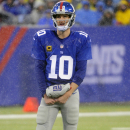 New York Giants quarterback Eli Manning (10) stands in the rain during the first half of an NFL football game against the Washington Redskins, Sunday, Dec. 29, 2013, in East Rutherford, N.J The Associated Press