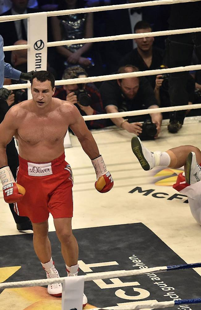 World boxing champion Wladimir Klitschko of Ukraine, left, knocks down Samoan-born Australian challenger Alex Leapai for the second  time  during their IBF, IBO, WBO and WBA heavyweight title bout in Oberhausen, Germany, Saturday, April 26, 2014. Klitschko won the fight by technical knock out in the fifth round