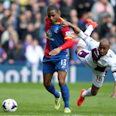 Crystal Palace's Jason Puncheon, left, battles for possession of the ball with Aston Villa's Fabian Delph, right, during their English Premier League soccer match at Selhurst Park, London, Saturday, April 12, 2014
