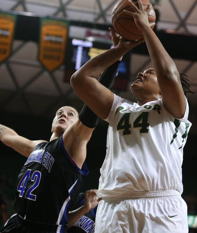 Oklahoma City's Autumn Lau (42) pressures Baylor Kristina Higgins during the first half of an NCAA college basketball exhibition game, Tuesday, Nov. 5, 2013, in Waco, Texas
