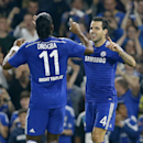 Chelsea's Cesc Fabregas, right, celebrates his opening goal with Chelsea's Didier Drogba during the Champions League Group G soccer match between Chelsea and Schalke 04 at Stamford Bridge stadium in London Wednesday, Sept. 17, 2014