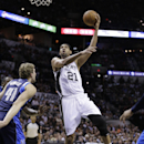 San Antonio Spurs' Tim Duncan (21) shoots over Dallas Mavericks' Dirk Nowitzki (41), of Germany, during the first half of Game 2 of the opening-round NBA basketball playoff series on Wednesday, April 23, 2014, in San Antonio The Associated Press