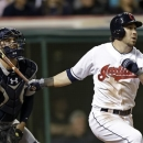 Cleveland Indians&#039; Jason Kipnis, right, watches his three-run home run with Seattle Mariners catcher Kelly Shoppach in the 10th inning to defeat the Mariners 6-3 in a baseball game on Friday, May 17, 2013, in Cleveland. (AP Photo/Mark Duncan)