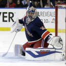 New York Rangers goalie Henrik Lundqvist (30) deflects a shot on goal during the third period of an NHL hockey game against the Detroit Red Wings, Sunday, March 9, 2014, in New York. The Rangers won the game 3-0. (AP Photo/Frank Franklin II)