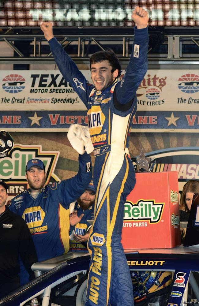 Chase Elliott celebrates after winning NASCAR Nationwide Series auto race at Texas Motor Speedway in Fort Worth, Texas, Friday, April 4, 2014. (AP Photo/Larry Papke)