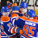 Edmonton Oilers forward Ryan Nugent-Hopkins (93) celebrates his game winning goal against the Tampa Bay Lightning with teammates, from left, Taylor Hall (obscured), Jordan Eberle (14), Mark Fayne (5), and Martin Marincin (85) during third period NHL hocke