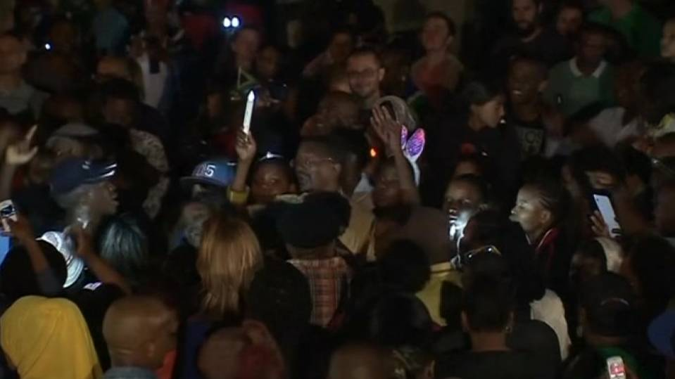 Crowds sing and dance at night outside Mandela's Houghton home