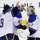 St. Louis Blues goalie Brian Elliott (1) celebrates his 1-0 shutout of the Pittsburgh Penguins with Blues goalie Ryan Miller (39) and Roman Polak (46) after an NHL hockey game in Pittsburgh, Sunday, March 23, 2014 The Associated Press