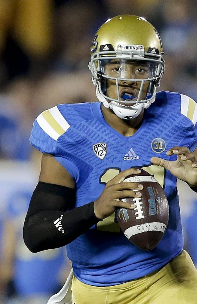 UCLA quarterback Brett Hundley rolls out to pass during the first half of an NCAA college football game against New Mexico State Saturday, Sept. 21, 2013, in Pasadena, Calif