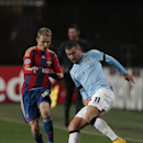 CSKA's Dmitri Efremov, left, vies for the ball with Manchester City's Aleksander Kolarov during the Champions League Group E soccer match between CSKA Moscow and Manchester City at Arena Khimki stadium in Moscow, Russia, Tuesday Oct. 21, 2014