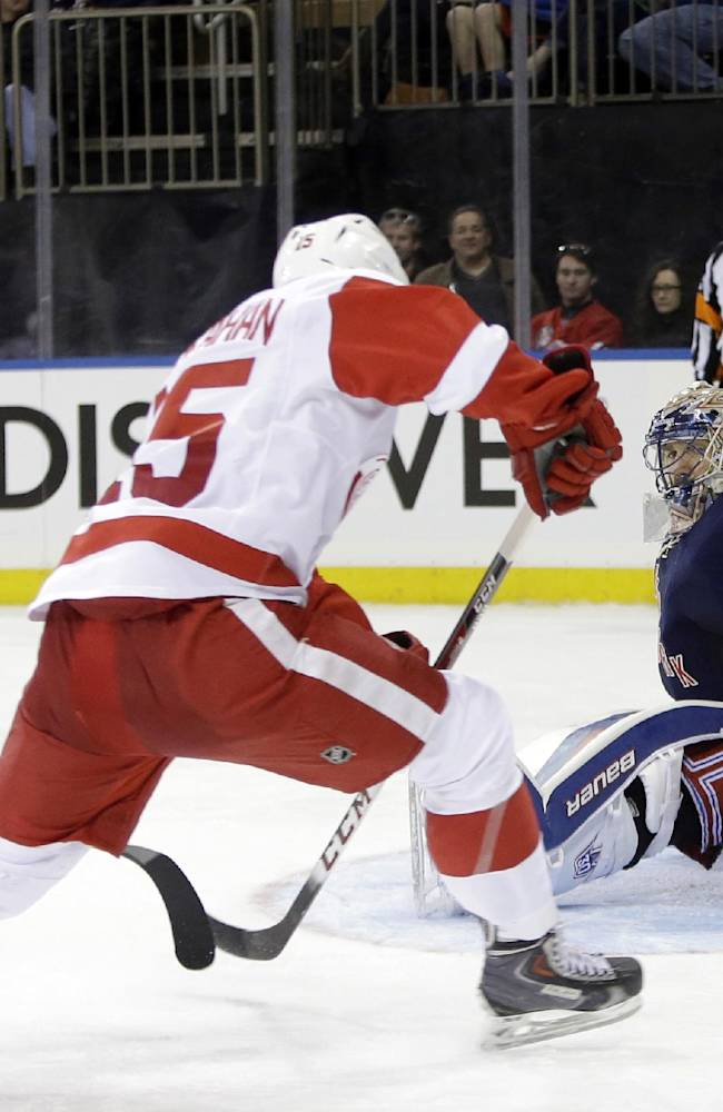 New York Rangers goalie Henrik Lundqvist (30), of Sweden, dives to stop a shot by Detroit Red Wings' Riley Sheahan (15) during the third period of an NHL hockey game on Sunday, March 9, 2014, in New York. The Rangers won the game 3-0
