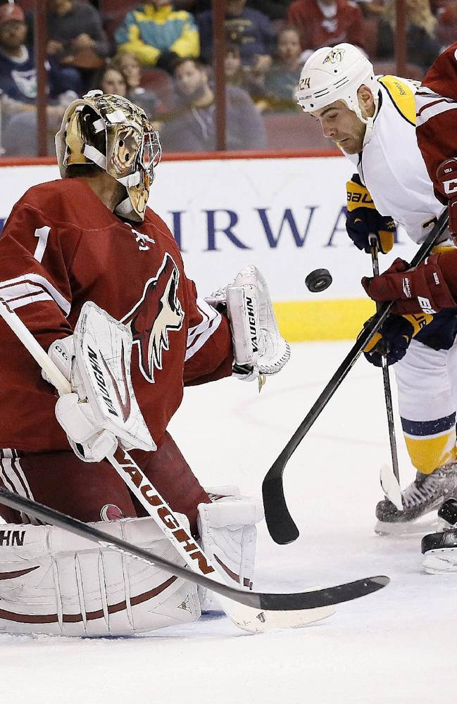 Nashville Predators' Eric Nystrom (24) flips the puck past Phoenix Coyotes' Thomas Greiss (1), of Germany, for a goal during the first period of an NHL hockey game Thursday, Oct. 31, 2013, in Glendale, Ariz