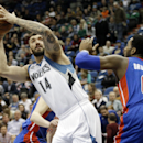 Minnesota Timberwolves' Nikola Pekovic, left, of Montenegro, eyes the basket as Detroit Pistons' Andre Drummond defends in the first quarter of an NBA basketball game, Friday, March 7, 2014, in Minneapolis The Associated Press