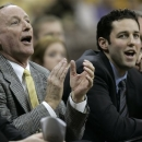 FILE - In this Dec. 2, 2005 file photo, Valparaiso coach Homer Drew, left, and his son and assistant coach Bryce Drew, right, react during the second half against Tulane at the Hawkeye Challenge in Iowa City, Iowa. For the last 3 decades, this has been life for the Drew family in northwestern Indiana -- a celebration of faith, family and Valpo basketball. (AP Photo/Charlie Neibergall, File)
