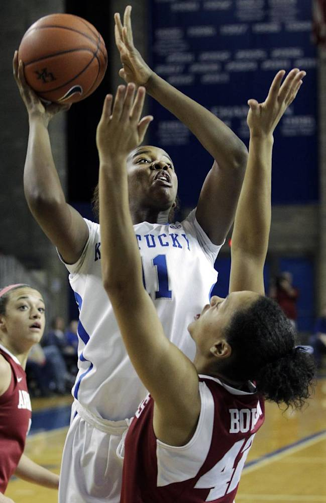Kentucky's DeNesha Stallworth, top, shoots as Arkansas' Jhasmin Bowen defends during the second half of NCAA women's college basketball game, Sunday, Jan. 26, 2014, in Lexington, Ky. Kentucky won 68-58