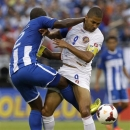 Honduras' Osman Chavez, left, and Costa Rica's Alvaro Saborio become entangled as they try to get possession of the ball during the first half in the quarterfinals of the CONCACAF Gold Cup soccer tournament on Sunday, July 21, 2013, in Baltimore. (AP Photo/Patrick Semansky)