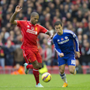 Liverpool's Glen Johnson, left, fights for the ball against Chelsea's Eden Hazard during the English Premier League soccer match between Liverpool and Chelsea at Anfield Stadium, Liverpool, England, Saturday Nov. 8, 2014