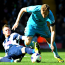 West Brom's Chris Brunt, left, tackles Tottenham's Harry Kane during the English Premier League soccer match between West Bromwich Albion and Tottenham Hotspur at The Hawthorns Stadium in West Bromwich, England, Saturday, April 12, 2014