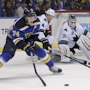St. Louis Blues' T.J. Oshie (74) looks to shoot the puck as San Jose Sharks goalie Antti Niemi (31) defends in the second period of an NHL hockey game, Thursday, Jan. 8, 2015 in St. Louis The Associated Press