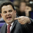 FILE - In this Jan. 31, 2013, file photo, Arizona head coach Sean Miller calls to his team during the first half of an NCAA college basketball game against Washington in Seattle. Raised by a basketball coach in a hardscrabble part of the country, Miller developed an intensity that helped him become a Division I point guard and one of the best coaches in the country. (AP Photo/Ted S. Warren, File)