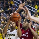 Michigan guard Trey Burke (3) shoots while defended by Nebraska guard David Rivers (2) in the second half of an NCAA college basketball game, Wednesday, Jan. 9, 2013, at Crisler Center in Ann Arbor, Mich. Michigan won 62-47. (AP Photo/Tony Ding)