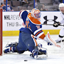 Los Angeles Kings Jeff Carter (77) watches the puck go in the net past Edmonton Oilers goalie Ben Scrivens (30) during first period NHL hockey action in Edmonton, Canada, Sunday March 9, 2014 The Associated Press