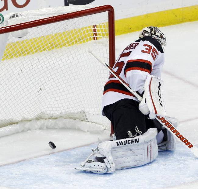 A shot by Minnesota Wild right wing Dany Heatley gets past New Jersey Devils goalie Cory Schneider (35) for a goal during the third period of an NHL hockey game in St. Paul, Minn., Sunday, Nov. 3, 2013. The Wild won Devils 4-0