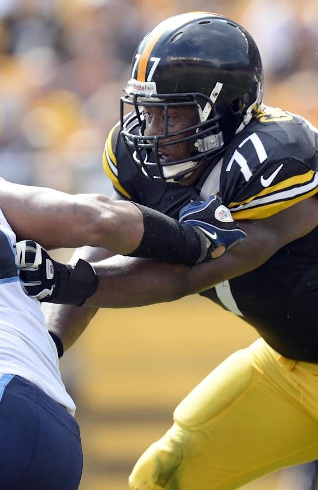 In this Sept. 8, 2013, file photo, Pittsburgh Steelers tackle Marcus Gilbert (77) blocks Tennessee Titans defensive end Derrick Morgan (91) during the third quarter of an NFL football game in Pittsburgh. Gilbert first met the Cincinnati Bengals' James Harrison at training camp with the Pittsburgh Steelers in 2011, but the two will play against each other Monday, Sept. 16, 2013