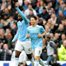 Manchester City's Yaya Toure, left, celebrates with teammate Samir Nasri after scoring from the penalty spot against Southampton during the English Premier League soccer match between Manchester City and Southampton at The Etihad Stadium, Manchester, Engl