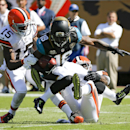 Jacksonville Jaguars' Ace Sanders (18) is brought down by Cleveland Browns wide receiver Marlon Moore (15) and cornerback Johnson Bademosi, right, during the first half of an NFL football game in Jacksonville, Fla., Sunday, Oct. 19, 2014 The Associated Pr