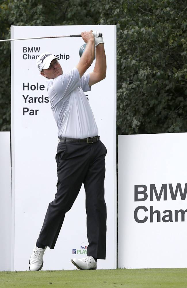 Steve Stricker watches his tee shot off the ninth hole during the pro-am round of the BMW Championship golf tournament at Conway Farms Golf Club in Lake Forest. Ill., Wednesday, Sept. 11, 2013