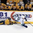 Vancouver Canucks right wing Dale Weise (32) is upended by Nashville Predators forward Viktor Stalberg (25), of Sweden, in the second period of an NHL hockey game Tuesday, Dec. 3, 2013, in Nashville, Tenn. Stalberg was penalized for tripping. (AP Photo/Mark Humphrey)