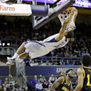 Washington's Andrew Andrews swings from the rim after missing on a dunk against Grambling during the first half of an NCAA college basketball game Wednesday, Dec. 17, 2014, in Seattle. (AP Photo/Elaine Thompson)