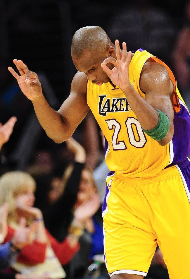 Los Angeles Lakers guard Jodie Meeks celebrate a 3-point shot in the first half of an NBA basketball game against the Dallas Mavericks, Friday, April 4, 2014, in Los Angeles