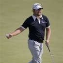 Ryan Moore reacts after putting for birdie on the fifth hole during the Justin Timberlake Shriners Hospitals for Children Open golf tournament, Thursday, Oct. 4, 2012, in Las Vegas. Moore finished at 10-under par for the round. (AP Photo/Julie Jacobson)