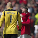Manchester United's Wayne Rooney, right, celebrates with teammate Ashley Young after scoring past Aston Villa goalkeeper Brad Guzan, foreground, during their English Premier League soccer match at Old Trafford Stadium, Manchester, England, Saturday March