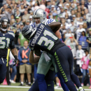 Dallas Cowboys' Jason Witten (82) is tackled by Seattle Seahawks strong safety Kam Chancellor after catching a pass for a touchdown in the first half of an NFL football game, Sunday, Oct. 12, 2014, in Seattle The Associated Press