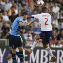 Tottenham Hotspur defender Jan Vertonghen, left, collides with MLS All-Star forward Clint Dempsey as they battle for the ball during the first half of the MLS All-Star soccer game Wednesday, July 29, 2015, in Commerce City, Colo. (AP Photo/David Zalubowsk
