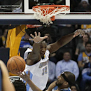 Minnesota Timberwolves' Corey Brewer, bottom tries to shoot around Denver Nuggets' Kenneth Faried during the first quarter of an NBA basketball game Monday, March 3, 2014, in Denver The Associated Press