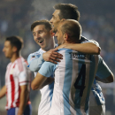 Argentina's Javier Pastore, center, celebrates with teammates Argentina's Lionel Messi and Argentina's Pablo Zabaleta after scoring his team's second goal against Paraguay during a Copa America semifinal soccer match at the Ester Roa Rebolledo Stadium in Concepcion, Chile, Tuesday, June 30, 2015. (AP Photo/Silvia Izquierdo)